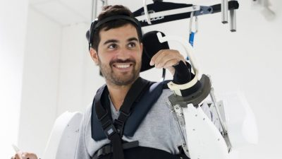 Paralyzed man moves in the brain-controlled exoskeleton